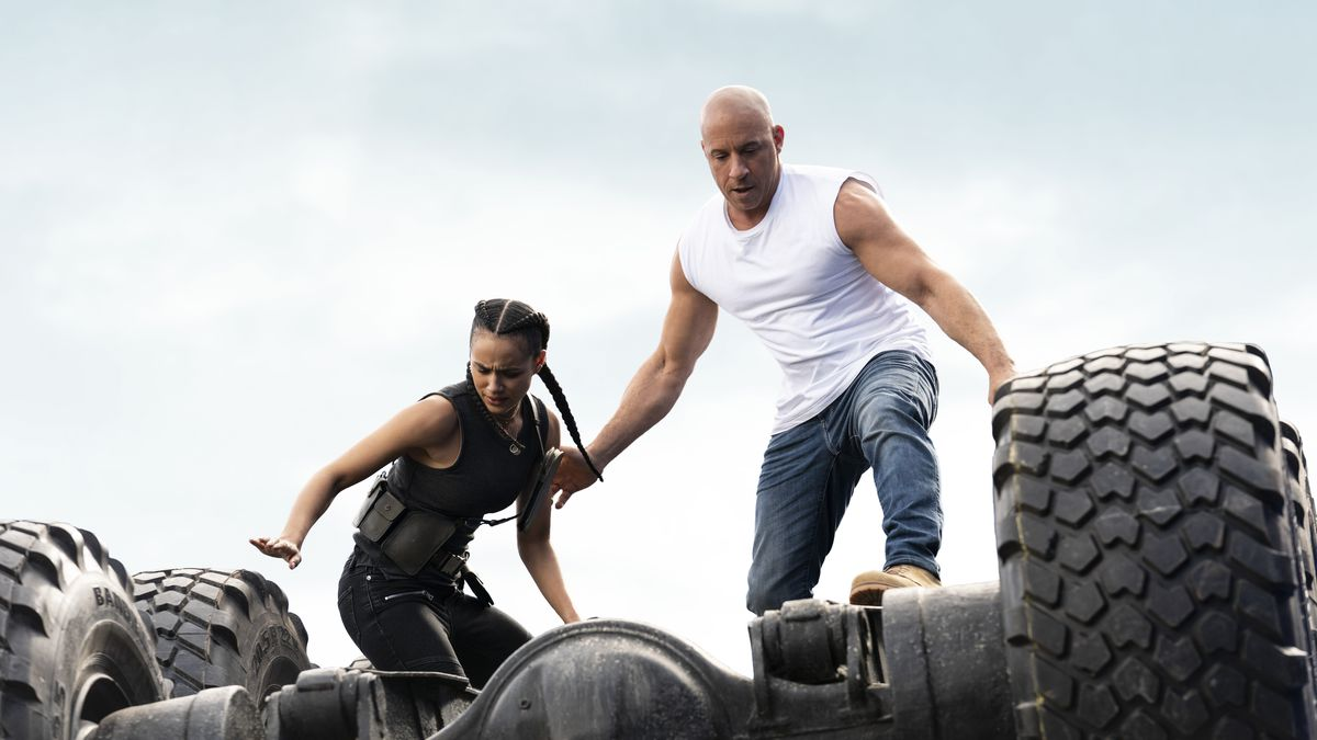 Ramsey (Nathalie Emmanuel) and Dom (Vin Diesel) atop an overturned truck in F9