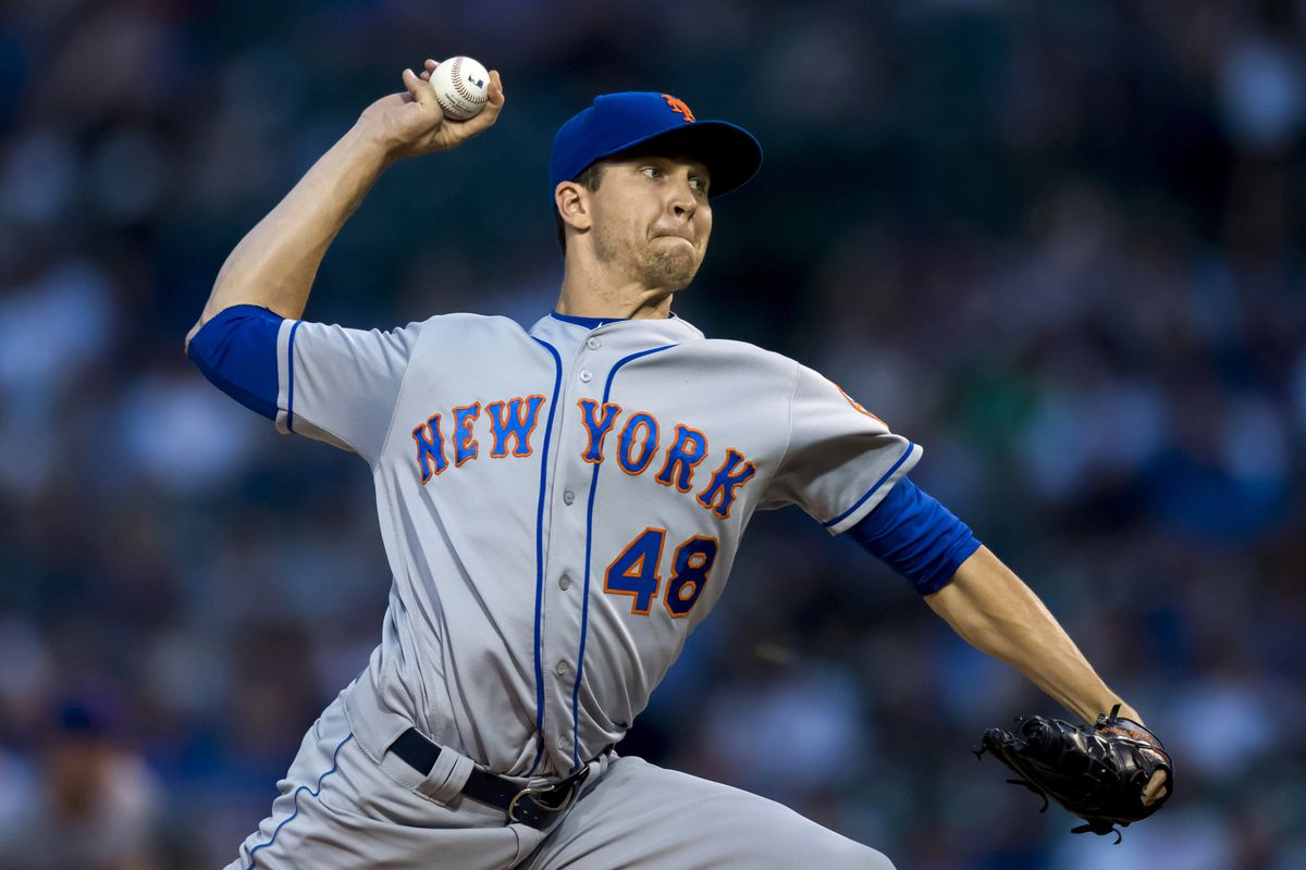 New York Mets starting pitcher Jacob DeGrom pitches during the first inning against the Chicago Cubs at Wrigley Field.