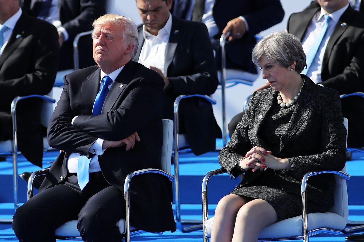 US President, Donald Trump and British Prime Minister, Theresa May are pictured ahead of a photo opportunity of leaders as they arrive for a NATO summit meeting on May 25, 2017 in Brussels, Belgium.