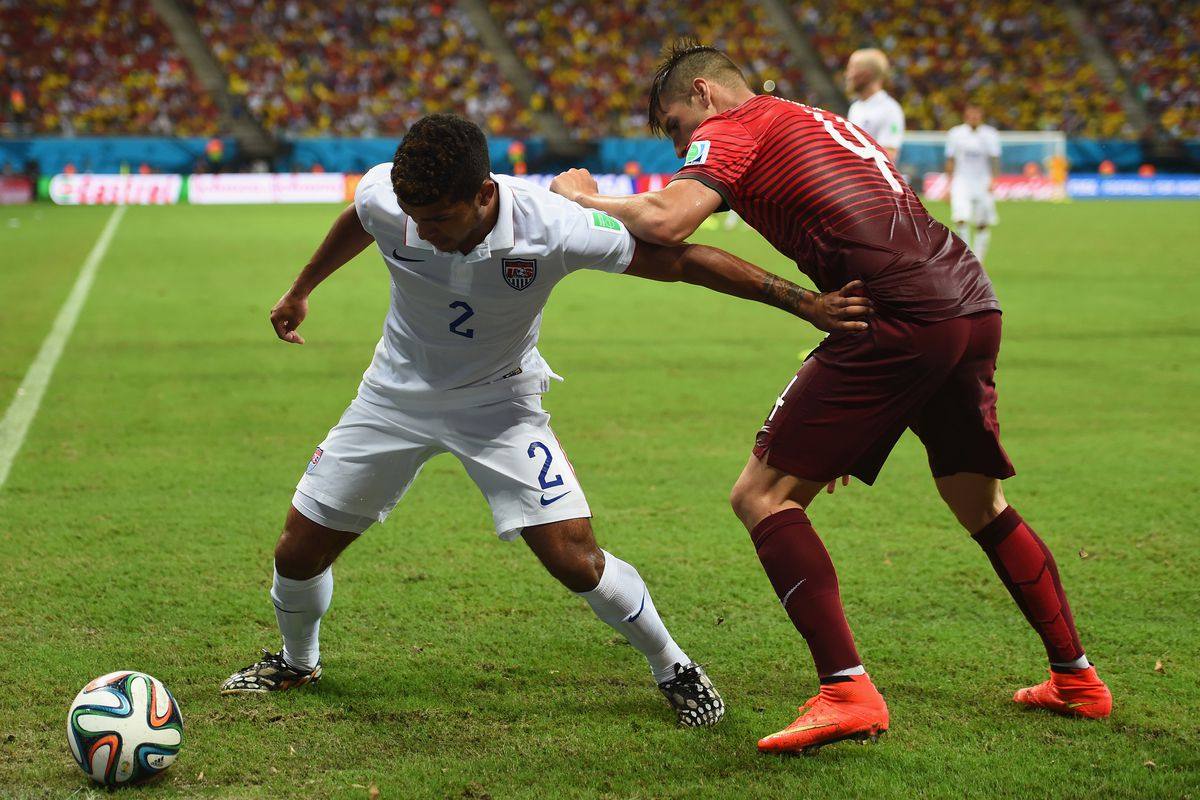 DeAndre Yedlin fights off Miguel Veloso in the dying minutes of the Yanks 2-2 draw against Portugal