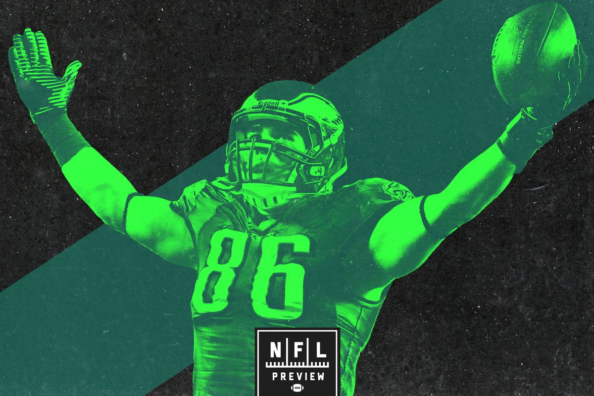 Zach Ertz celebrating with his hands up, holding the football. The image is different shades of green.