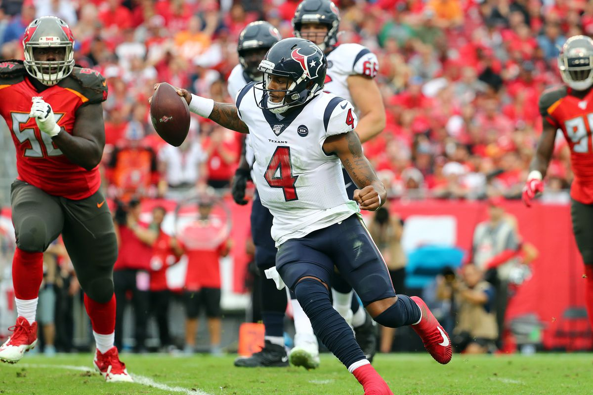 Houston Texans quarterback Deshaun Watson runs with the ball against the Tampa Bay Buccaneers during the second half at Raymond James Stadium
