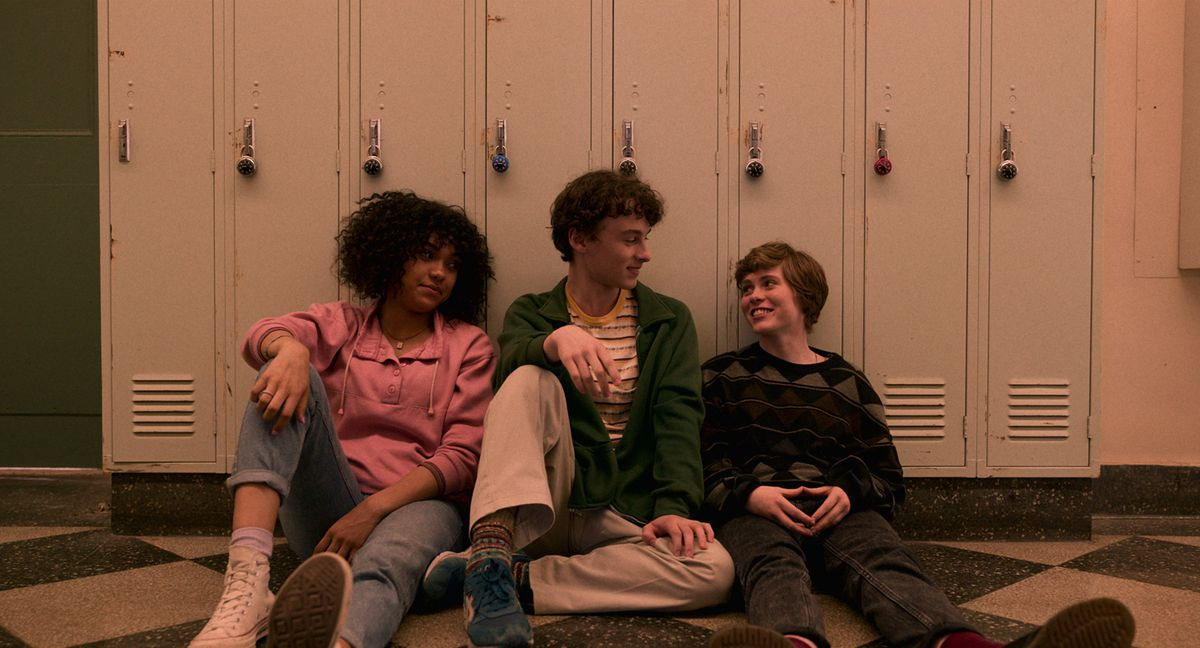 Dina, Stan, and Syd all sit on the floor of their school hallway, leaning against lockers in I Am Not Okay With This