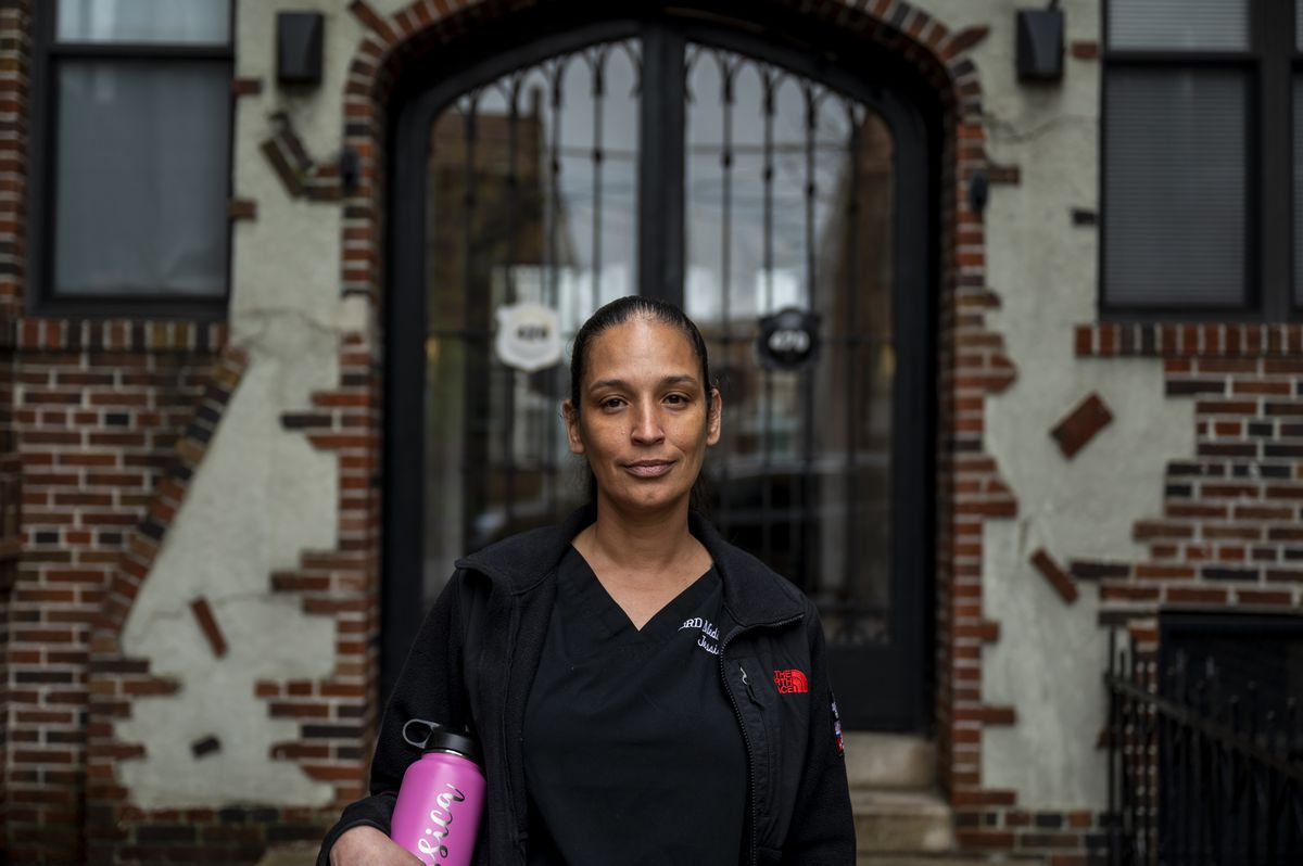 Jessica Santiago outside her building at the center of a court battle.