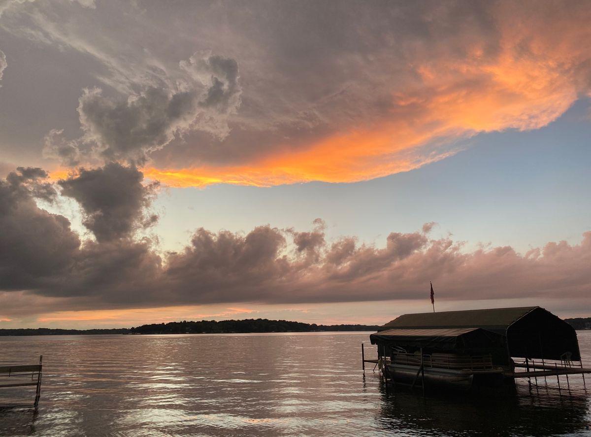 Lake and docks with an orange sunset