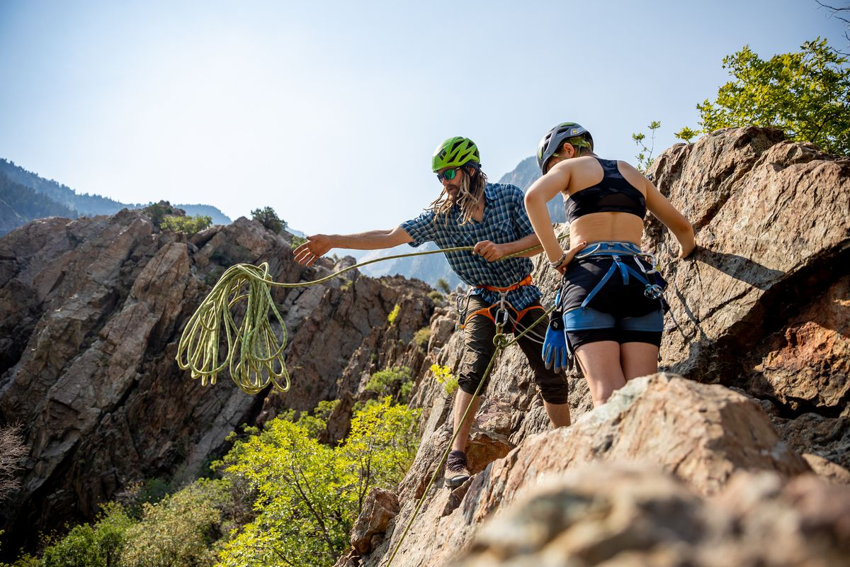 Kevin Learned, a ski and rock climbing guide for Utah Mountain Adventures, sets up a rappel with his client, Julia Redden, 15, at the top of a climb in the Storm Mountain area of Big Cottonwood Canyon on Saturday, July 24, 2021.