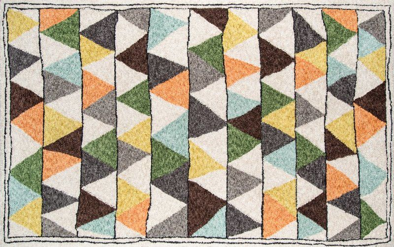 A rug with a colorful geometric pattern.