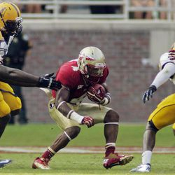Florida State running back Chris Thompson (4 ) finds a hole in the Murray State defense in the first half of an NCAA college football game, Saturday, Sept. 1, 2012, in Tallahassee, Fla.