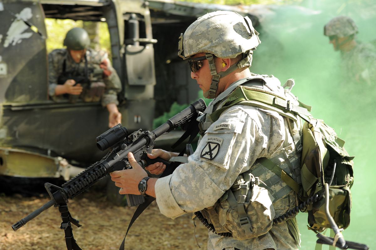 Fort Benning, GA, USA; Team 7 First lt. Oleg Sheynfeld provides security for Cpt. Ian Kent with the 10th Mountain Division during the Ranger first responder course on day two of the 30th U.S. Army Best Ranger Competition at Fort Benning.