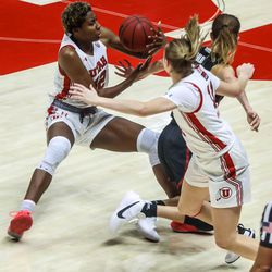Utah Utes forward Peyton McFarland (42) tries to corral the ball during a Pac-12 women's basketball game against the Stanford Cardinal at the Huntsman Center in Salt Lake City on Friday, Jan. 15, 2021.