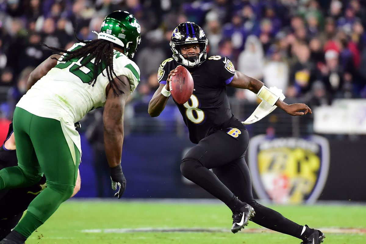 Baltimore Ravens quarterback Lamar Jackson runs with the ball in the third quarter against the New York Jets at M&T Bank Stadium.