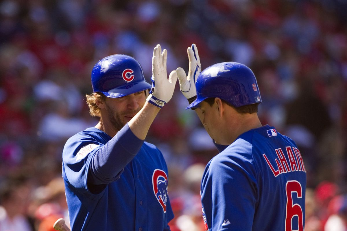 Philadelphia, PA, USA; Chicago Cubs first baseman Bryan LaHair celebrates scoring with left fielder Joe Mather against the Philadelphia Phillies at Citizens Bank Park. The Cubs defeated the Phillies 5-1.  Credit: Howard Smith-US PRESSWIRE