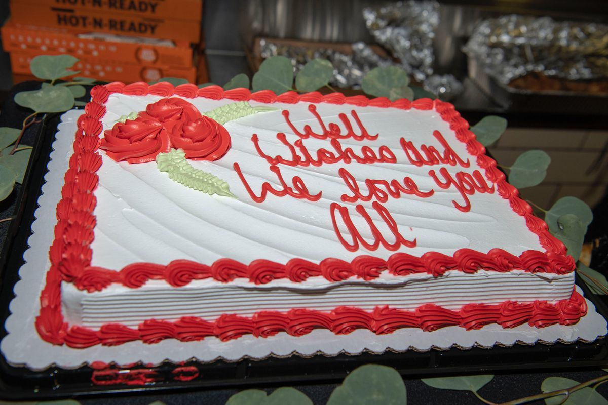 """A cake ordered for Delta Prep's farewell party reads """"well wishes and we love you all."""" Delta Prep shared a red-and-white color scheme with its namesake sorority."""