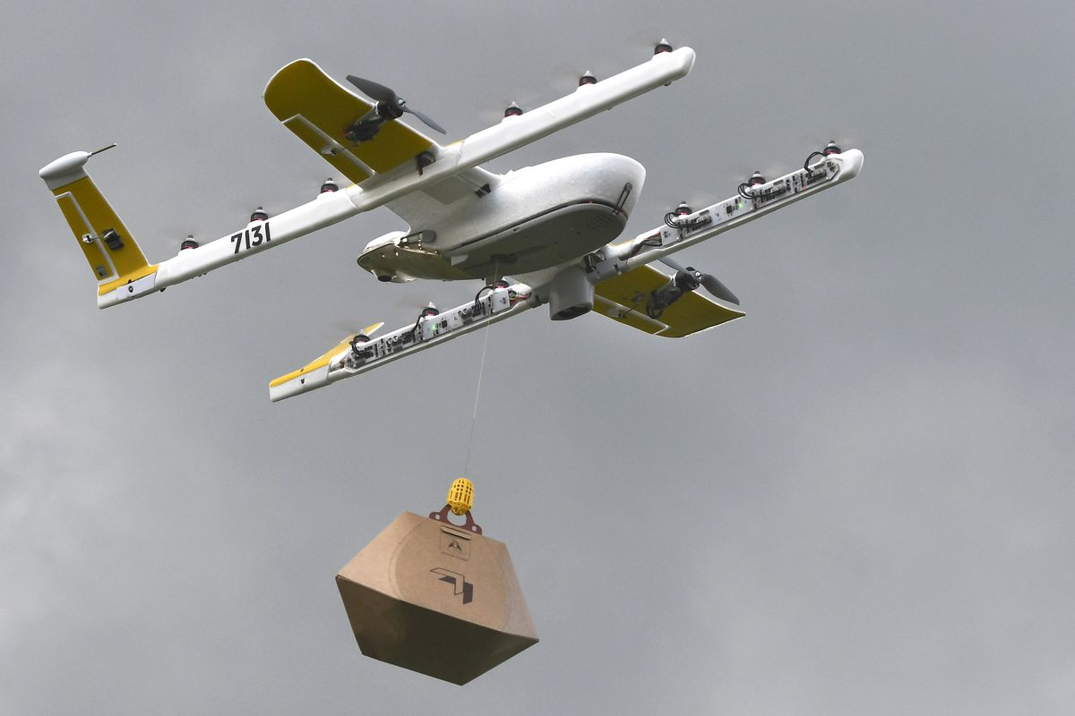 In this Tuesday, Aug, 7, 2018, photo a Wing Hummingbird drone carries a package of ice cream and popsicles as it leaves its launch site during a delivery flight demonstration in Blacksburg, Va.