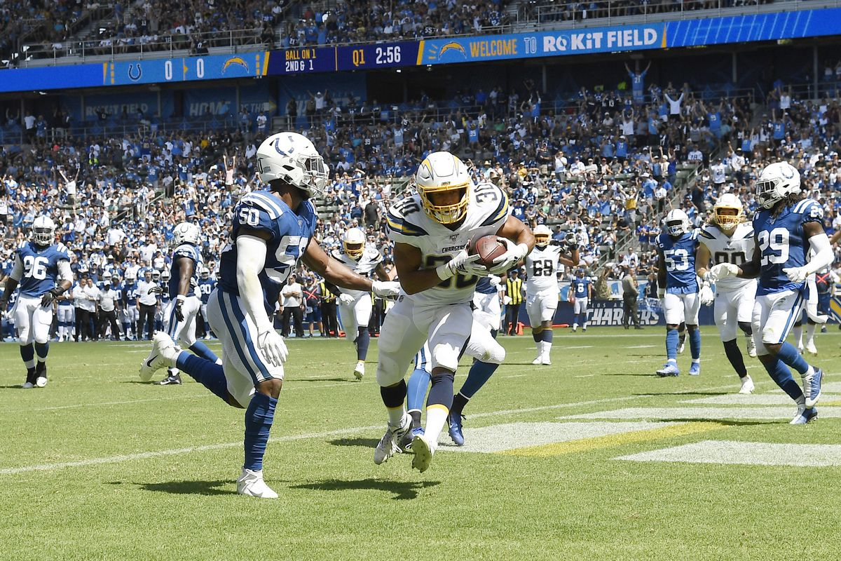 Running back Austin Ekeler of the Los Angeles Chargers scores a touchdown against middle linebacker Anthony Walker #50 of the Indianapolis Colts during the first half at Dignity Health Sports Park on September 8, 2019 in Carson, California.