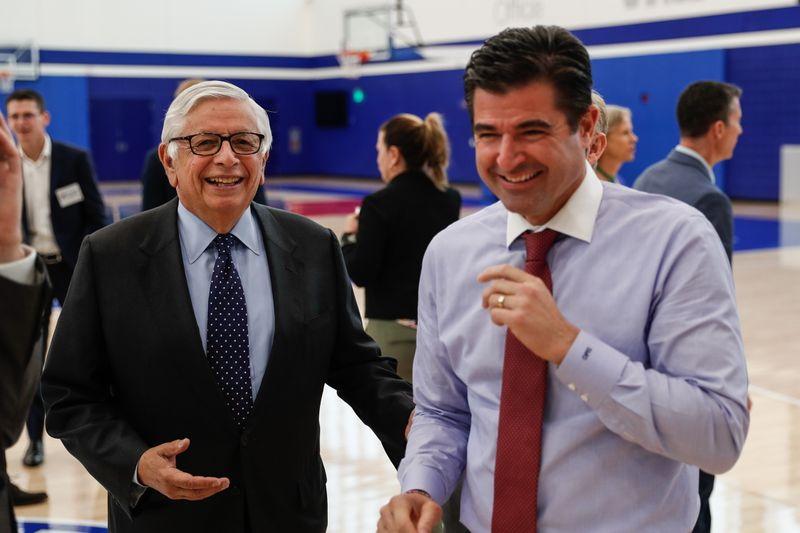 Philadelphia 76ers CEO Scott O'Neil shares a laugh with former NBA commissioner David Stern.