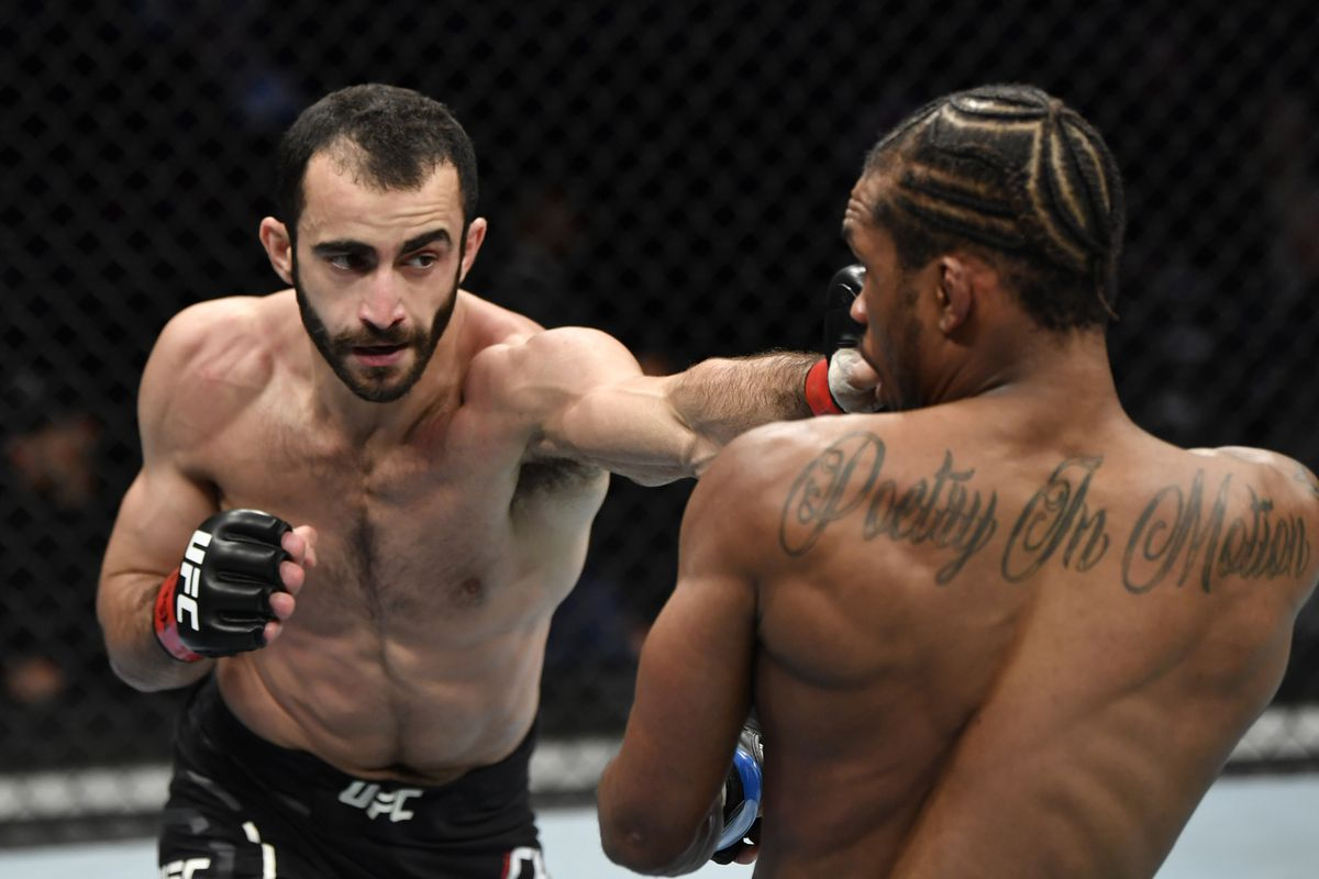 Giga Chikadze of Georgia punches Jamall Emmers in their featherweight fight during the UFC 248 event at T-Mobile Arena on March 07, 2020 in Las Vegas, Nevada.