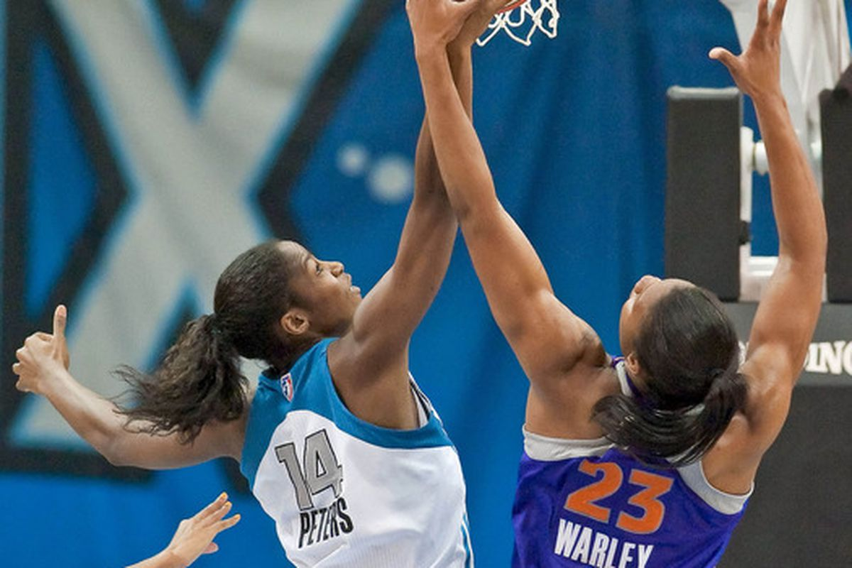 While Minnesota Lynx rookie Devereaux Peters is having a very productive learning year, undrafted rookie Avery Warley is making an impact on the boards. <em>Photo by Greg Smith-US PRESSWIRE.</em>
