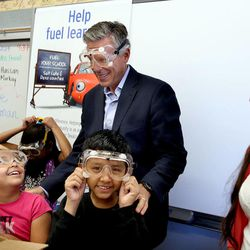 Former U.S. Ambassador to China, Utah Governor and current Chevron board of directors member Jon Huntsman Jr. helps students unwrap STEM related teaching materials with Grace Lugo and Hassan Hamid, fourth-graders, and their teacher Melody Francis at Rose Park Elementary School in Salt Lake City on Wednesday, Sept. 3, 2014.