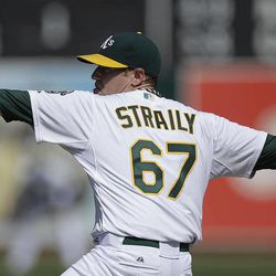 Oakland Athletics' Dan Straily works against the Seattle Mariners in the first inning of a baseball game Saturday, Sept. 29, 2012, in Oakland, Calif.