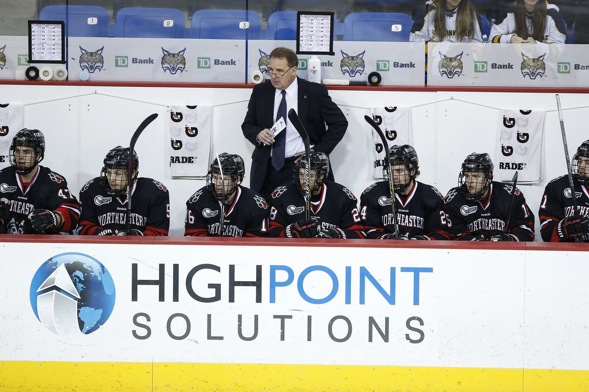 Northeastern coach Jim Madigan behind the Huskies' bench for the team's game at Quinnipiac during the 2014-15 season.