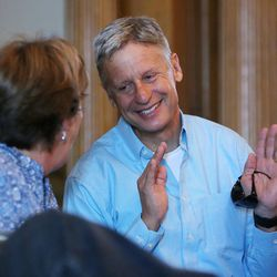 Libertarian presidential candidate Gov. Gary Johnson talks with friend Kathy Hunter as he and running mate Gov. Bill Weld pay a visit to Salt Lake City for a speech at the University of Utah on Saturday, Aug. 6, 2016.