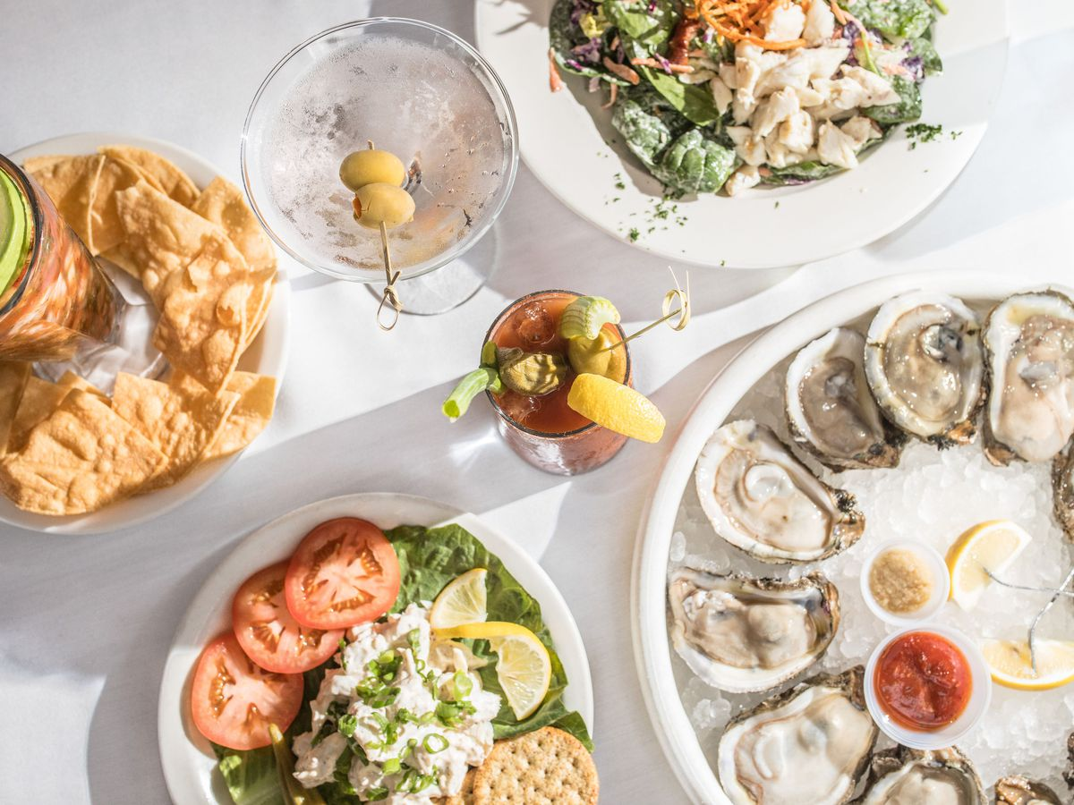 oysters on the half shell, crab salad, and cocktails