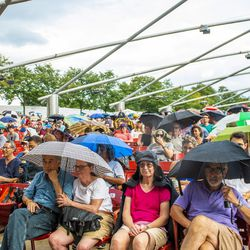 Despite the light showers, fans listen to the Darcy James Argue's Secret Society. Sept. 1, 2018.   Tyler LaRiviere/Sun-Times