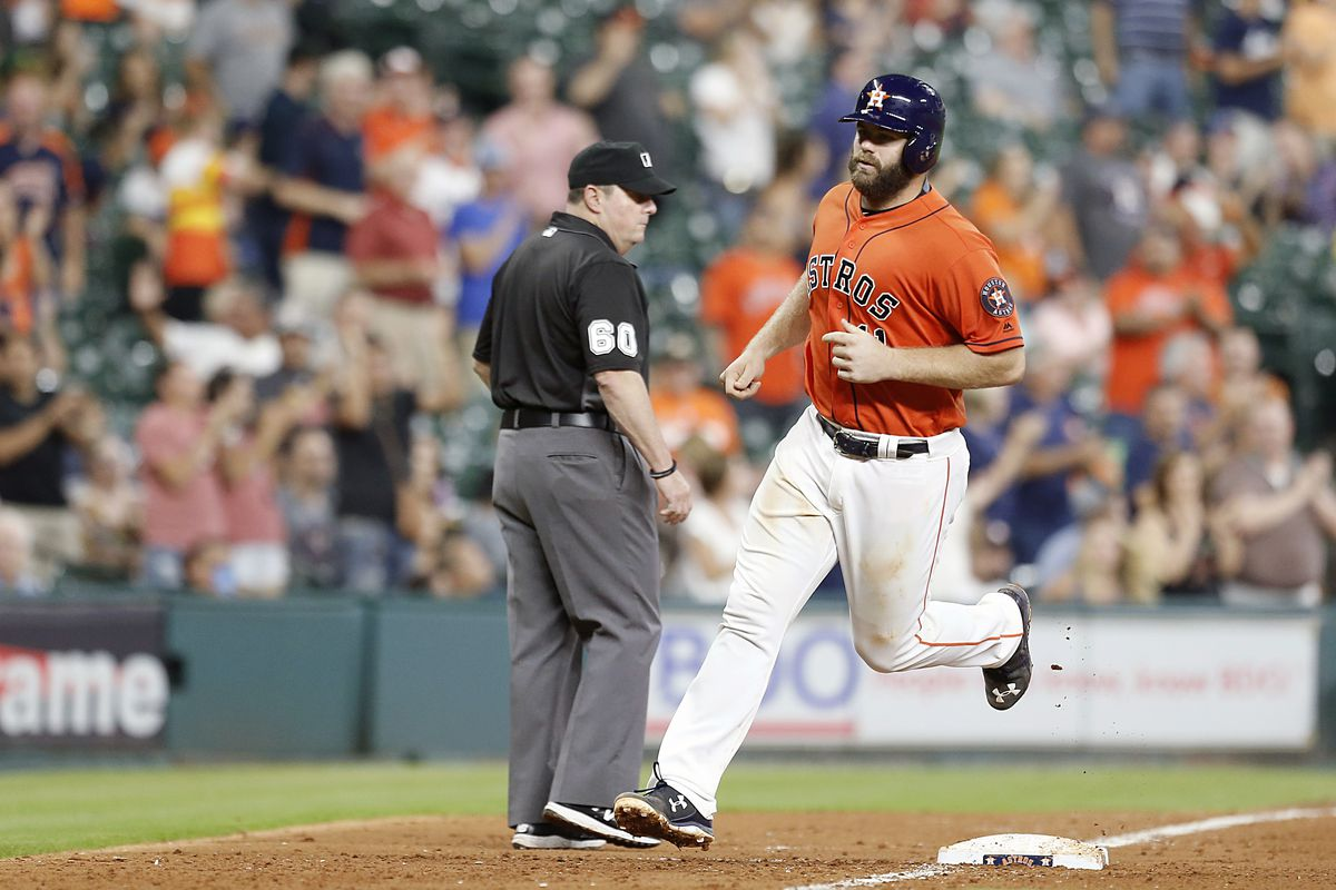 Evan Gattis trots home after crushing a 2-run home run to left field in the 4th inning.