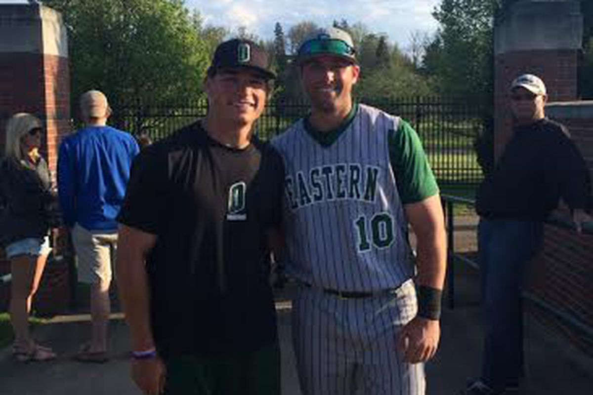 Mitch (left) and Lee Longo (right) brothers meet up in Athens for the EMU/Ohio series.
