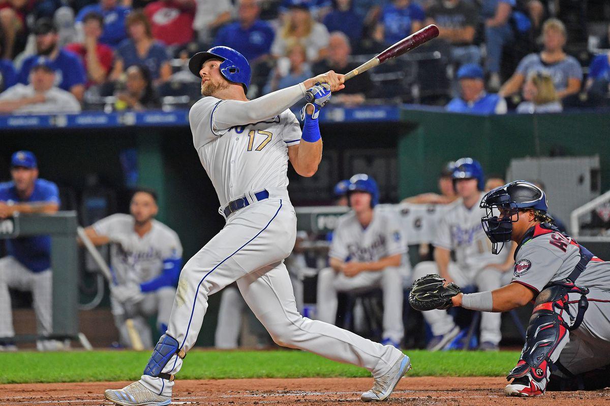 Kansas City Royals third baseman Hunter Dozier doubles during the first inning against the Minnesota Twins at Kauffman Stadium.