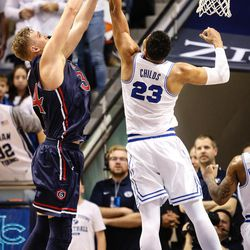 Brigham Young Cougars forward Yoeli Childs (23) out-rebounds Saint Mary's Jock Landale (34) as the BYU Cougars take on the Saint Mary's Gaels in the Marriott Center in Provo on Saturday, Dec. 30, 2017.