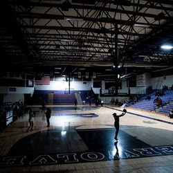Zariah Jenkins shoots around under emergency lighting after power went out at the start of the girls basketball game between Riverton and Syracuse at Riverton High School on Tuesday, Dec. 15, 2020.