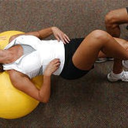 Kim Faulkner of Murray performs crunches on a Physio-ball at the Sports Mall. These exercises help strengthen a skier's abdominal and gluteal muscles.