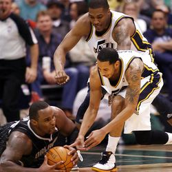 Utah Jazz guard Devin Harris (5) tries to get a lose ball #11 Glen Davis as the Utah Jazz and the Orlando Magic play Saturday, April 21, 2012 in Energy Solutions arena.