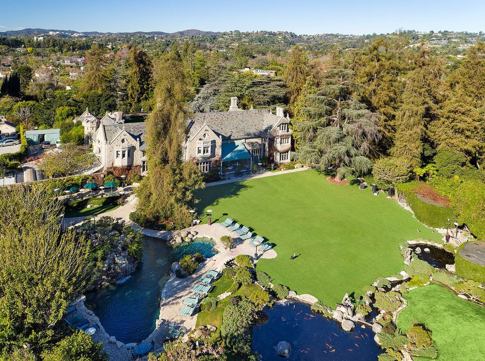 The Playboy Mansion and its large yard and famous grotto.