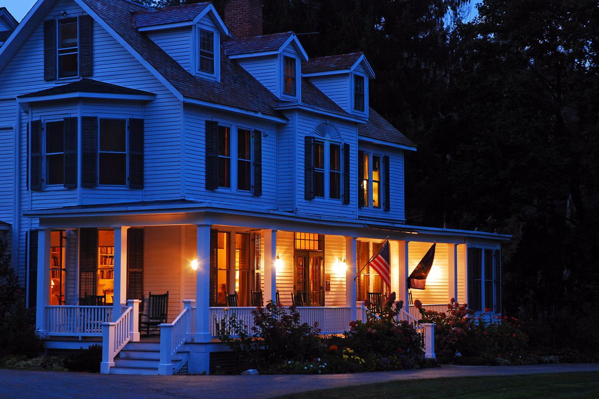 House At Night With Lower Level Lights On