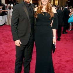 Christian Bale and his wife Sibi Blazic are both wearing Dolce & Gabbana, found at the Shops at Crystals, and Cartier, found at Wynn Las Vegas.