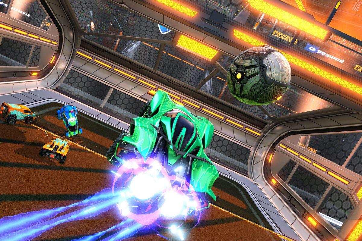 A Rocket League player  jumps toward a ball
