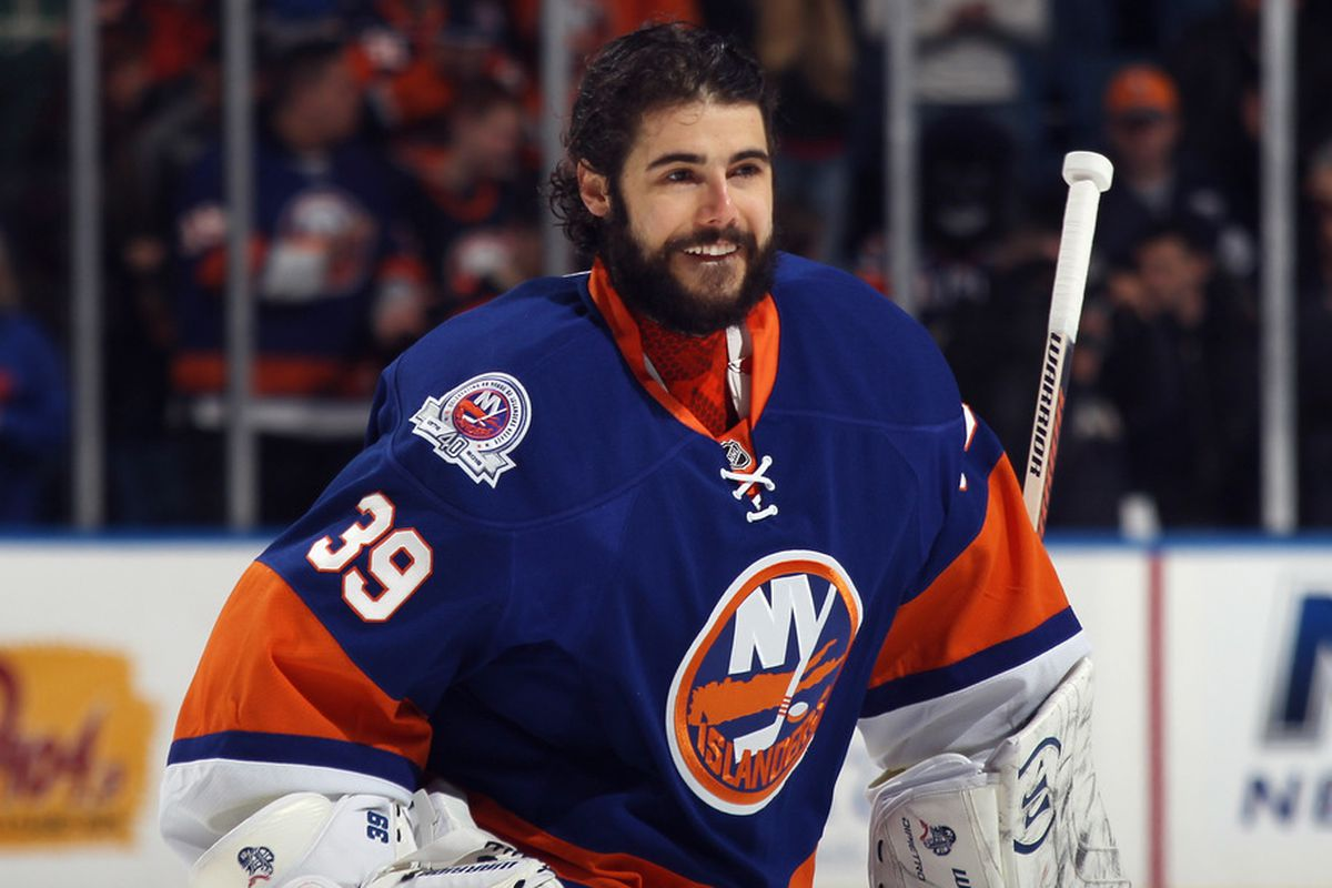 UNIONDALE, NY - OCTOBER 29: Rick DiPietro #39 of the New York Islanders skates out to face the San Jose Sharks at Nassau Veterans Memorial Coliseum on October 29, 2011 in Uniondale, New York.  (Photo by Bruce Bennett/Getty Images)