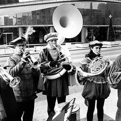 Poor Richard's Brass Quintet performs downtown in December 1989. Musicians are, from left, Jeff Gurr, Keith Davis, Ken Wright, Lyric Montgomery and Jeff Steffen.