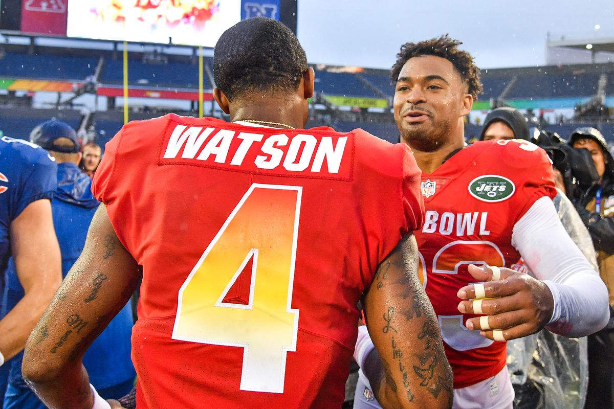 Deshaun Watson #4 of the Houston Texans and Jamal Adams #33 of the New York Jets celebrate after the 2019 NFL Pro Bowl at Camping World Stadium on January 27, 2019 in Orlando, Florida.