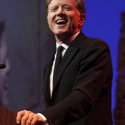 """Jamie Redford laughs as he tells funny stories about his father, Robert Redford. For all his contributions to the state of Utah, Robert Redford was recognized and honored by Governor Gary Herbert at a gala in his honor, """"The Governor's Salute to Robert Redford: A Utah Tribute to an American Icon"""" at the Grand America Hotel, Saturday, November 9, 2013. Redford is an actor, director, producer, philanthropist, businessman, environmentalist, and founder of the Sundance Resort, the Sundance catalog, and the Sundance Institute which hosts the Sundance Film Festival."""