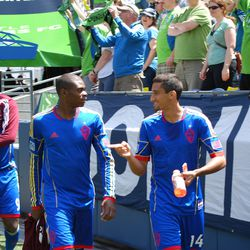 Tony Cascio and Anthony Wallace discuss matters before kickoff while Edson Buddle dons his top.