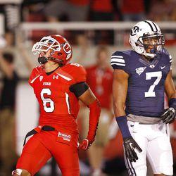Utah Utes wide receiver Dres Anderson (6) celebrates his touchdown as Brigham Young Cougars defensive back Preston Hadley (7) walks away as the University of Utah and BYU play football Saturday, Sept. 15, 2012, in Salt Lake City, Utah.