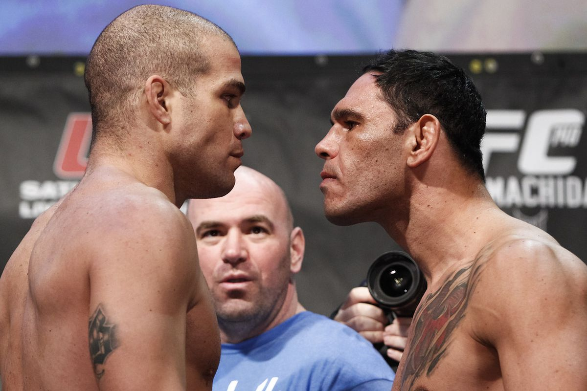 "Photo by Esther Lin via <a href=""http://www.blogcdn.com/www.mmafighting.com/media/2011/12/030titoortizandantoniorogerionogueira.jpg"" target=""new"">MMA Fighting</a>."