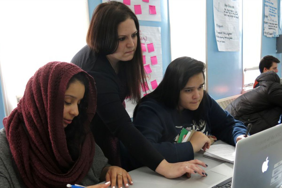 Teacher Marisa Laks, center, works with students in 2014 ahead of a Regents exam the following week.