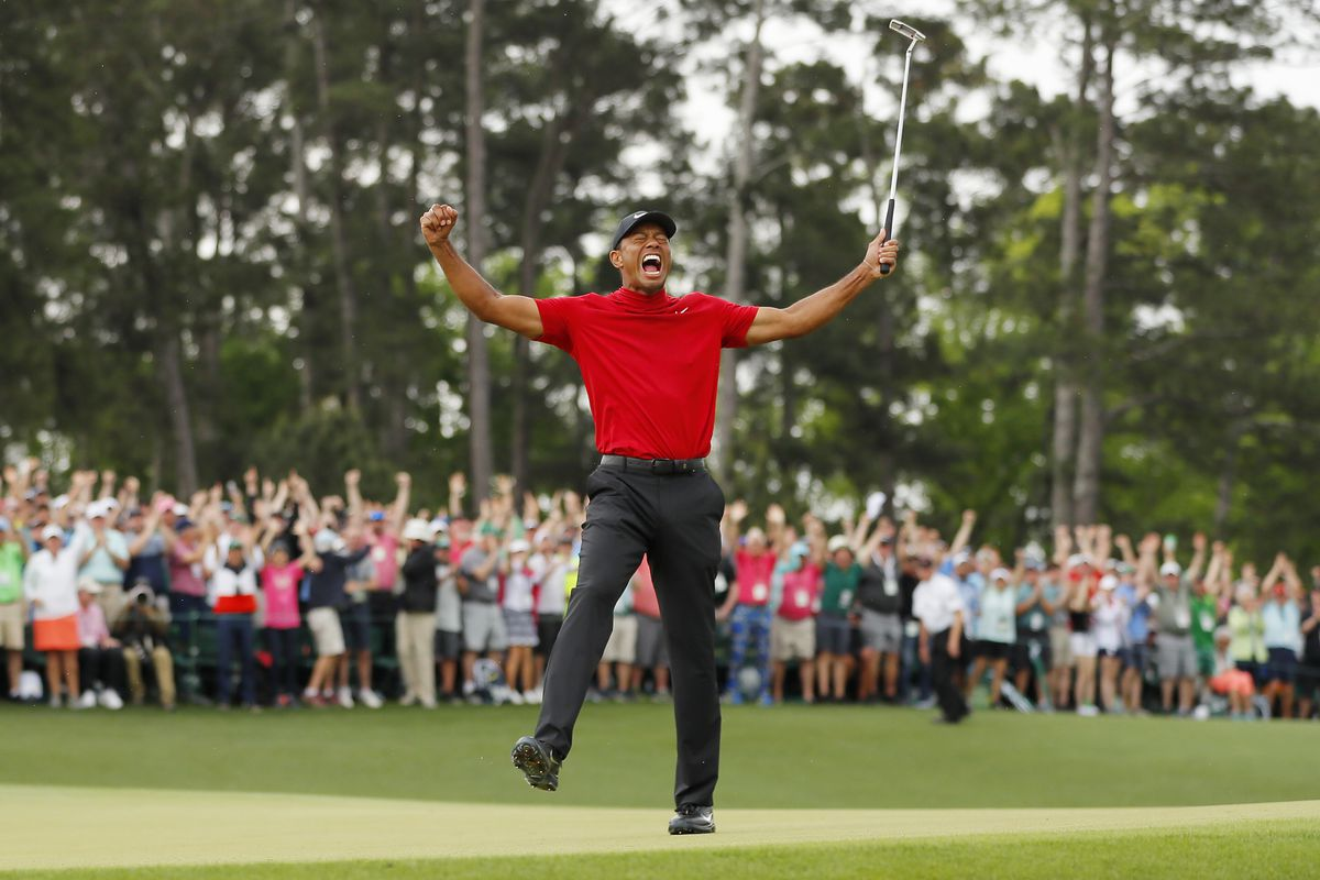 af01aeec Tiger Woods celebrates after sinking his putt on the 18th green to win  during the final round of the Masters at Augusta National Golf Club on  April 14, ...