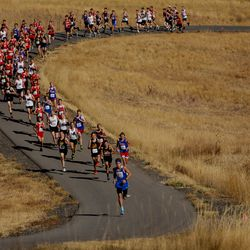 Runners work through a paved section during the 3A boys state cross-country championship race at Soldier Hollow in Midway on Thursday, Oct. 22, 2020.