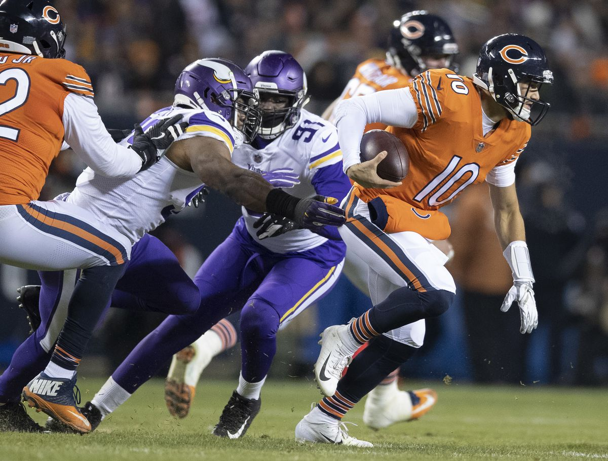 Chicago Bears quarterback Mitchell Trubisky (10) avoid Vikings defensive players Minnesota Vikings defensive end Danielle Hunter (99), and defensive end Stephen Weatherly (91) in the second quarter at Soldier Field Sunday November 18, 2018 in Chicago IL